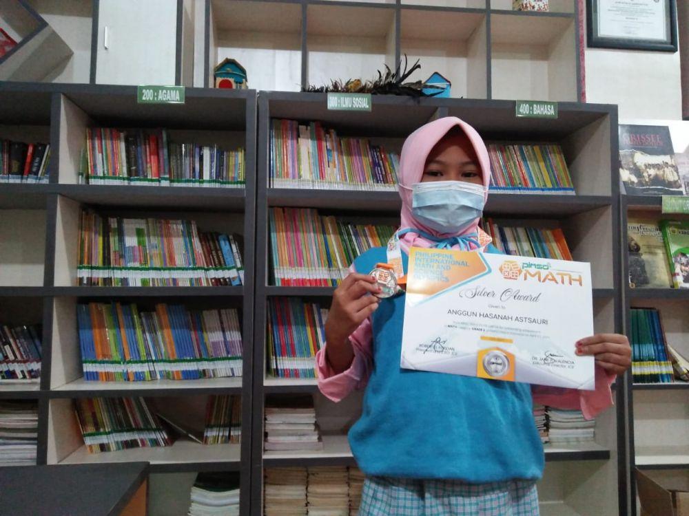 Anggun Hasana Astsauri Siswi Kelas III MINU Trate Putri Gresik Berprestasi Nasional 2021